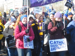 "Two junior members carry the ""Catholic Daughters of the Americas"" banner during the 2014 March for Life in Washington, D.C."