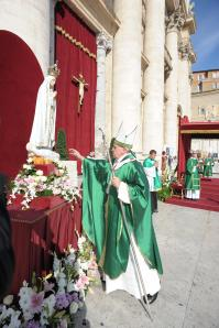 Pope Francis makes a gesture of affection towards a statue of Our Lady of Fatima in Portugal.