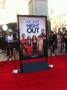 """""""Moms' Night Out"""" poster graces the red carpet during the April 29 premiere in Los Angeles. The film opens nationwide Friday, May 9."""